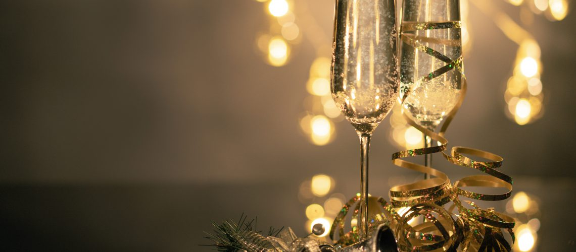 close-up-of-two-flute-glasses-filled-with-sparkling-wine-3036525